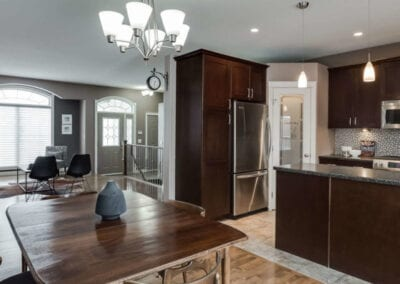 clean kitchen, dining room and living room